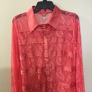 Beautiful sheer lace blouse by BKE Boutique